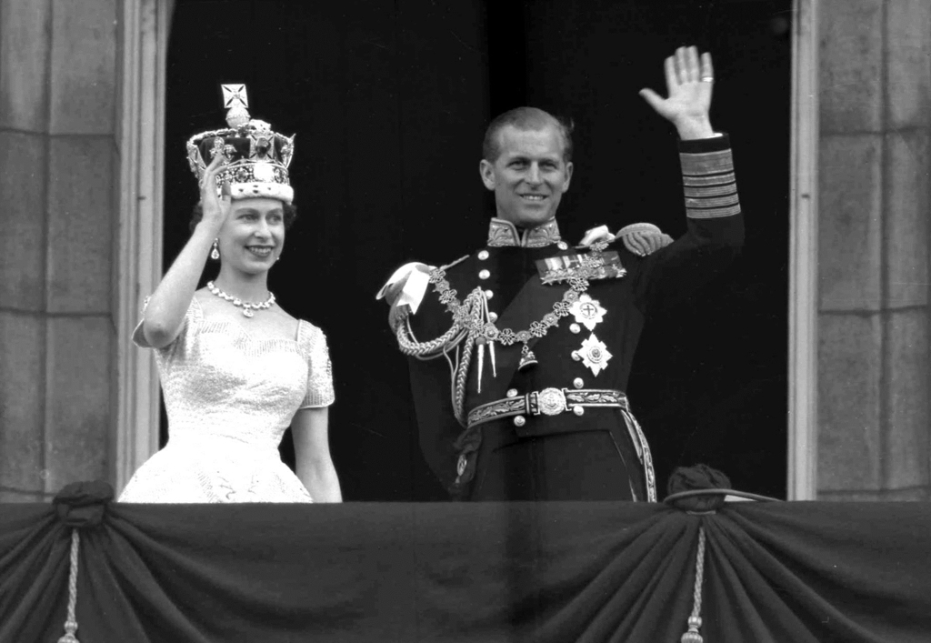 FILE - This is a June. 2, 1953 file photo of Britain's Queen Elizabeth II and Prince Philip, Duke of Edinburgh, as they wave to supporters from the ba...