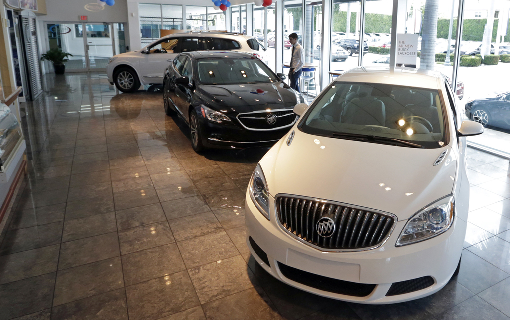 In this Wednesday, April 26, 2017, photo, 2017 Buick automobiles appear on display in the showroom at a GMC Buick dealership in Miami. U.S. sales of n...