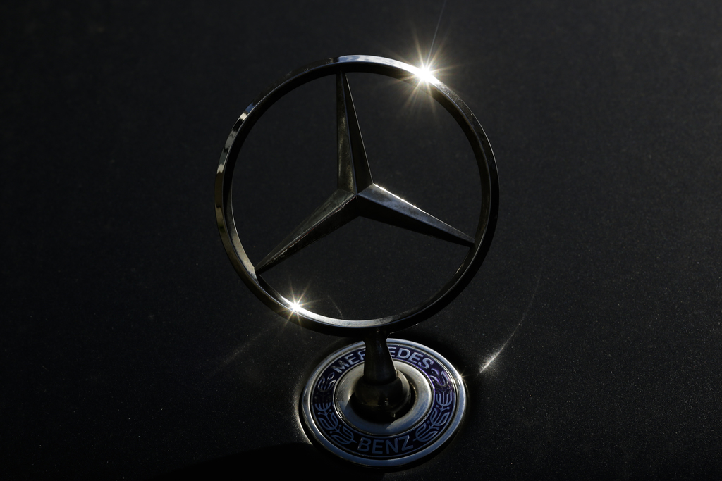The brand logo of German car maker Mercedes Benz is photographed on a car in Berlin, Tuesday, Aug. 1, 2017. German Transport Minister Alexander Dobrin...