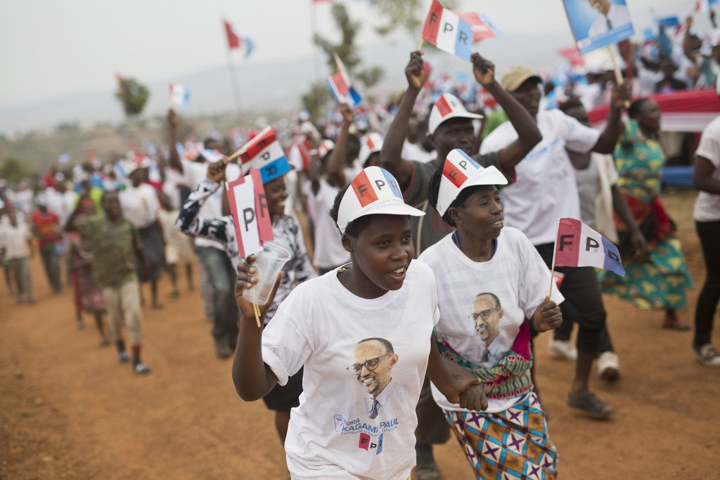 Supporters of Rwanda's President Paul Kagame, center, attend an election campaign rally on the hills overlooking Kigali, Rwanda, Wednesday Aug. 2, 201...