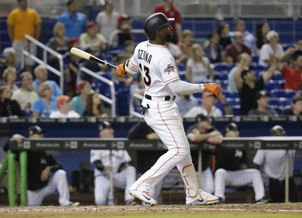 Miami Marlins' Marcell Ozuna watches his three-run home run during the fifth inning against the Washington Nationals in a baseball game, Tuesday, Aug....