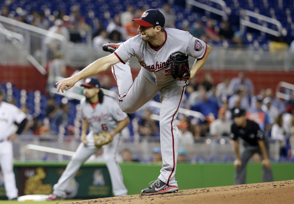 Washington Nationals starting pitcher Max Scherzer follows through on a delivery during the first inning of the team's baseball game against the Miami...