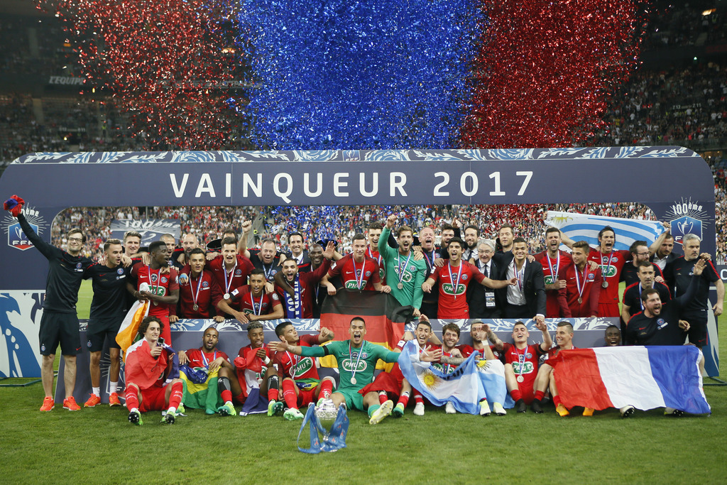 FILE - In this May 27, 2017 file photo, the Paris Saint-Germain's team celebrate with their trophy after winning the French Cup 2017 Final soccer matc...