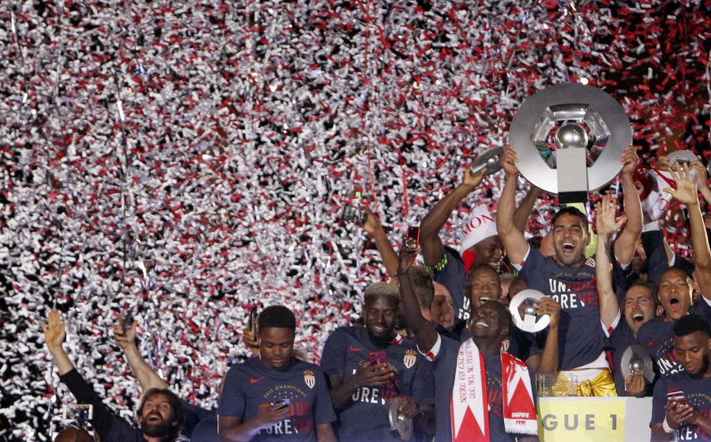 FILE - In this May 17, 2017 file photo, Monaco players hold the trophy as they celebrate their French League One title after beating Saint Etienne dur...