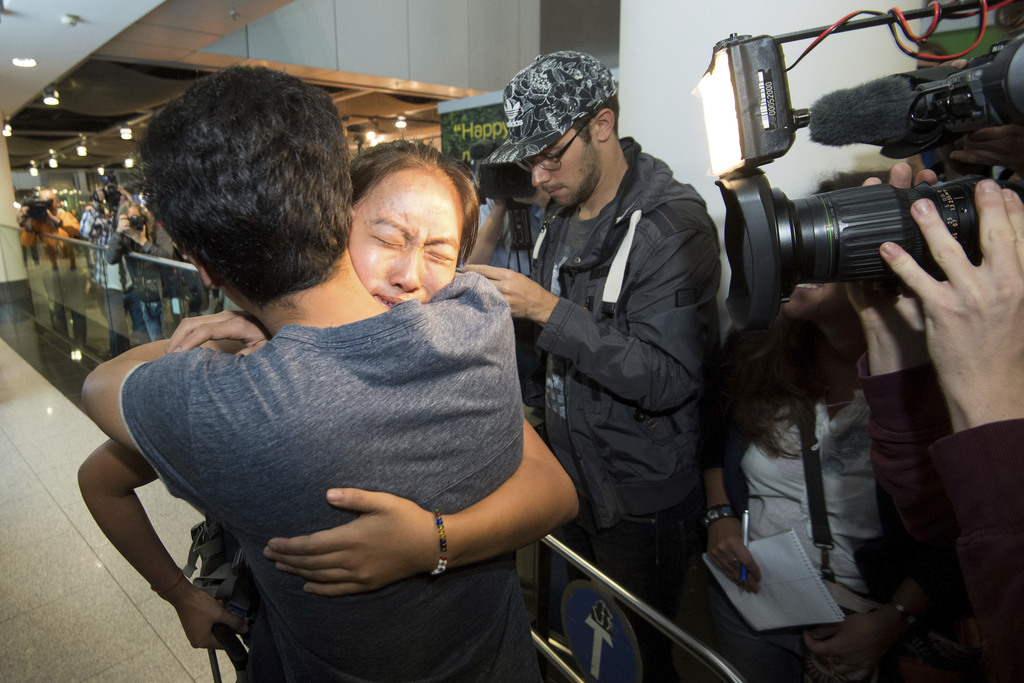 Schoolgirl Bivsi Rana from Nepal  arrives to the airport and is greeted by her brother Biswash in Dusseldorf, Germany, Wednesday, Aug. 2,  2017. The s...