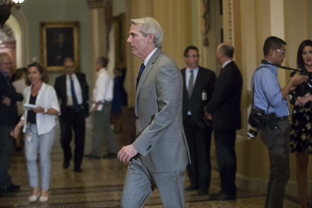 Sen. Rob Portman, R-Ohio, walks to the Senate chamber on Capitol Hill Washington, Tuesday, Aug. 1, 2017, as work resumes after the Republican health c...