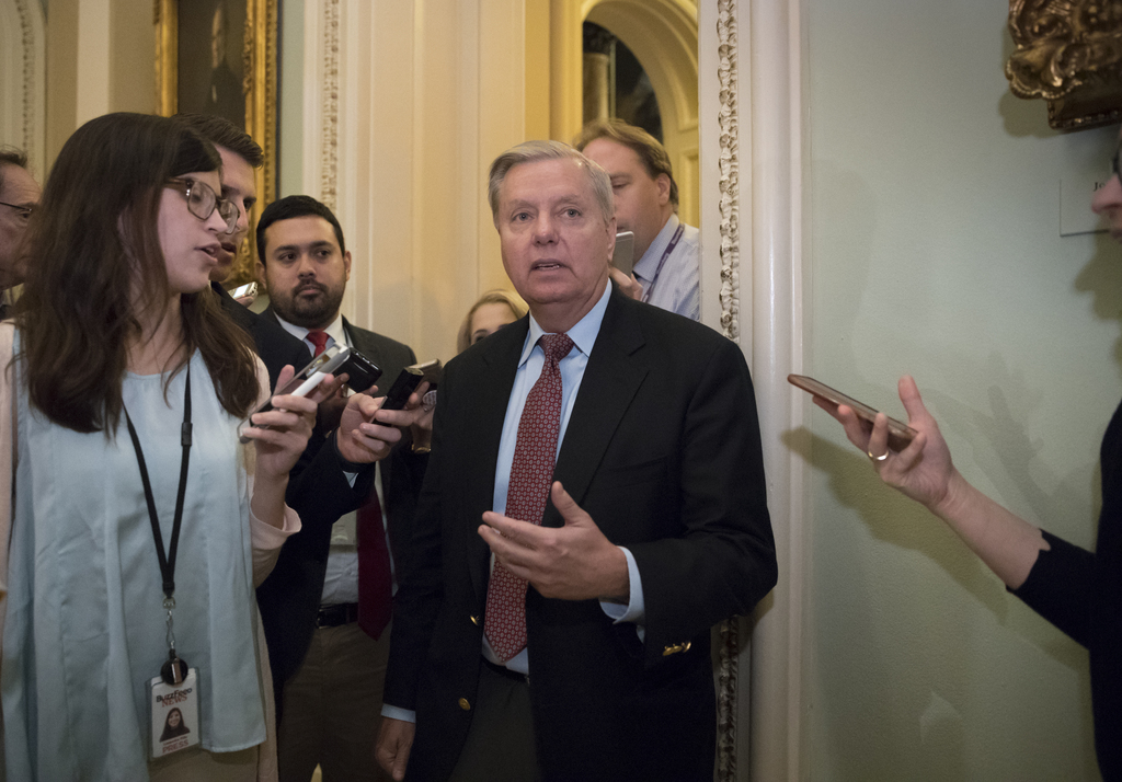 Sen. Lindsey Graham, R-S.C., chairman of the Senate Judiciary Subcommittee on Crime and Terrorism, arrives on Capitol Hill Washington, Tuesday, Aug. 1...