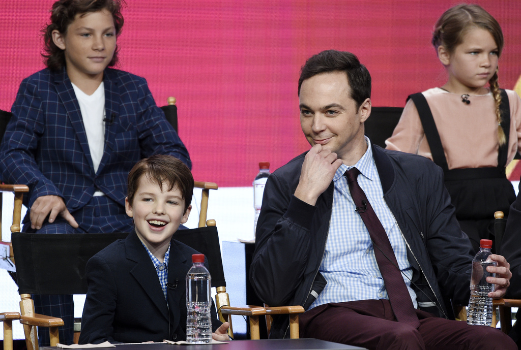 "Iain Armitage, front left, a cast member in the CBS series ""Young Sheldon,"" answers a question as executive producer/narrator Jim Parsons, front right..."