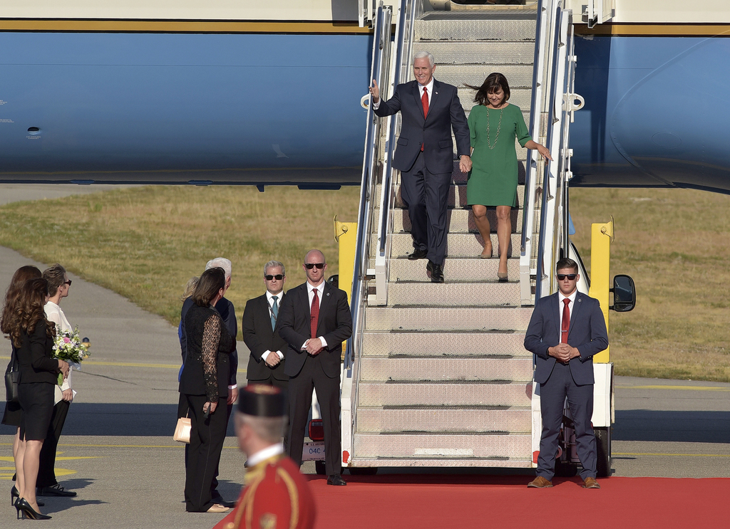 U.S. Vice President Mike Pence, left, and his wife Karen Pence arrive at Golubovci airport, near Podgorica, Montenegro, Tuesday, Aug. 1, 2017. Pence w...