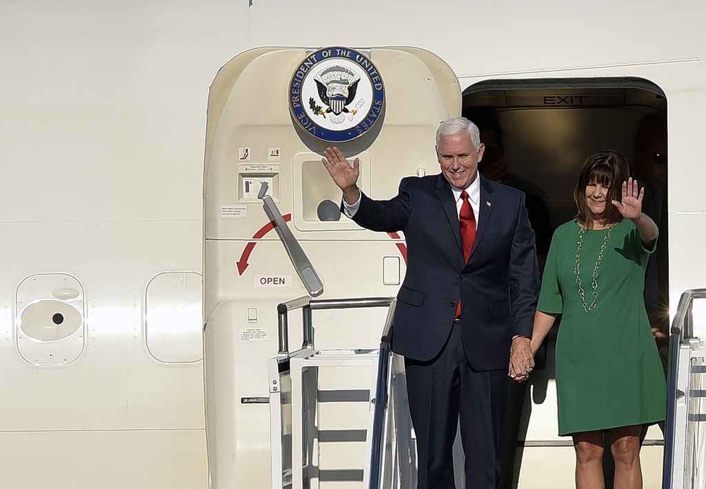 U.S. Vice President Mike Pence, left, and his wife Karen Pence wave as they arrive at Golubovci airport, near Podgorica, Montenegro, Tuesday, Aug. 1, ...