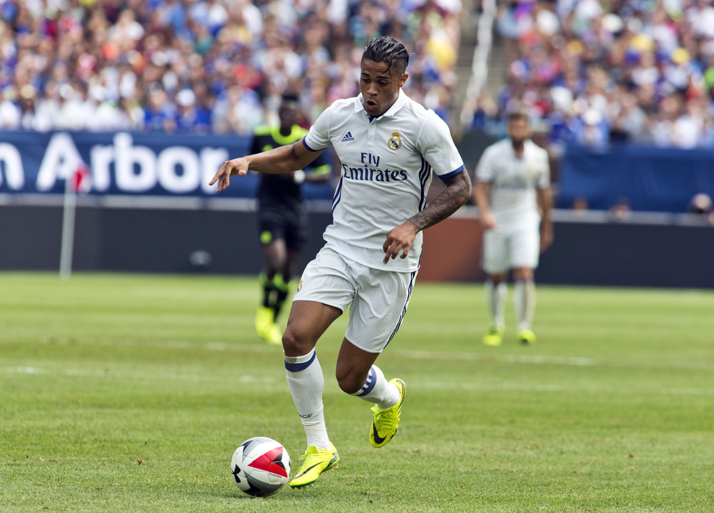 FILE- In this July 30, 2016 file photo, Real Madrid forward Mariano Diaz Mejia dribbles the ball in the first half of an International Champions Cup s...