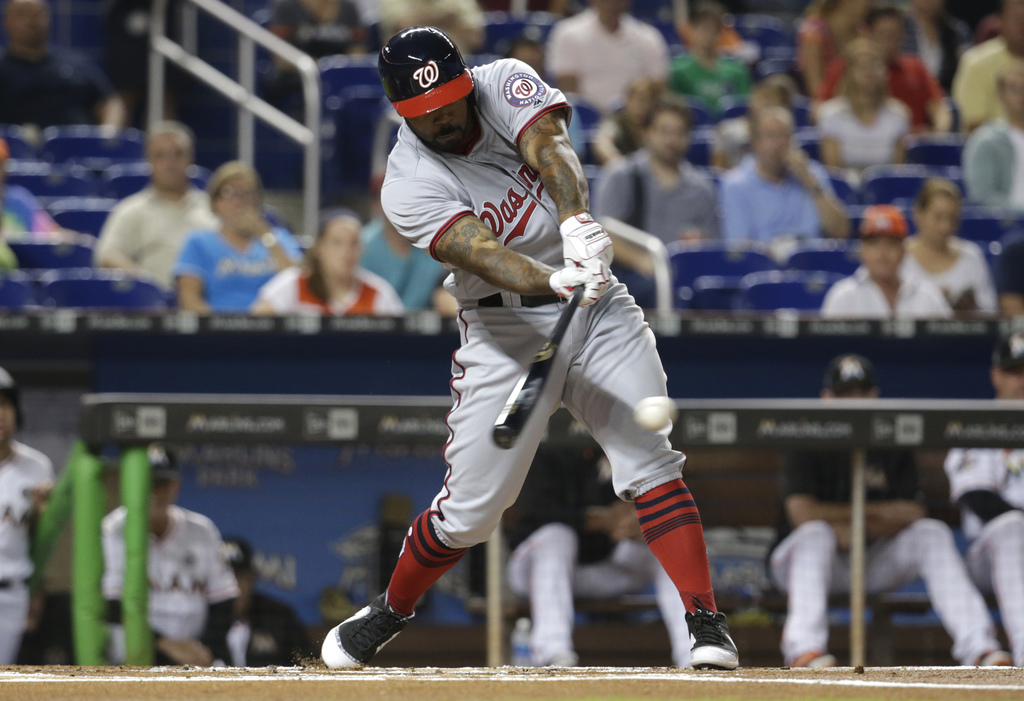 Washington Nationals' Howie Kendrick hits a single during the first inning against the Miami Marlins in a baseball game Tuesday, Aug. 1, 2017, in Miam...