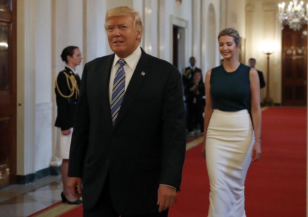 President Donald Trump, followed by his daughter Ivanka Trump, walks to the East Room of the White House in Washington, Tuesday, Aug. 1, 2017, to spea...