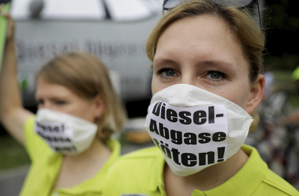 "A demonstrator wearing a face mask with the inscription ""Kill diesel emissions"" protests the ""Diesel Summit"" that is to take place in Berlin, Germany,..."
