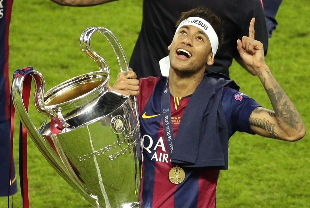 FILE - In this Saturday, June 6, 2015 file photo, Barcelona's Neymar celebrates with the trophy after the Champions League final soccer match between ...