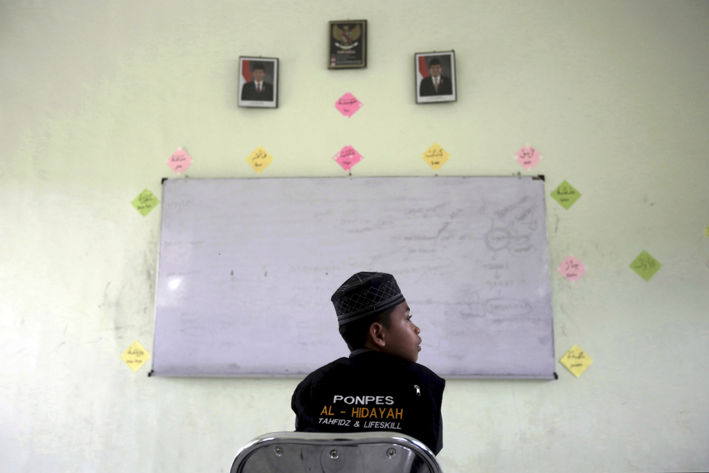 In this July 22, 2017, file photo, a student sits in a classroom at Al Hidayah Islamic Boarding School in Sei Mencirim, North Sumatra, Indonesia. Pupi...