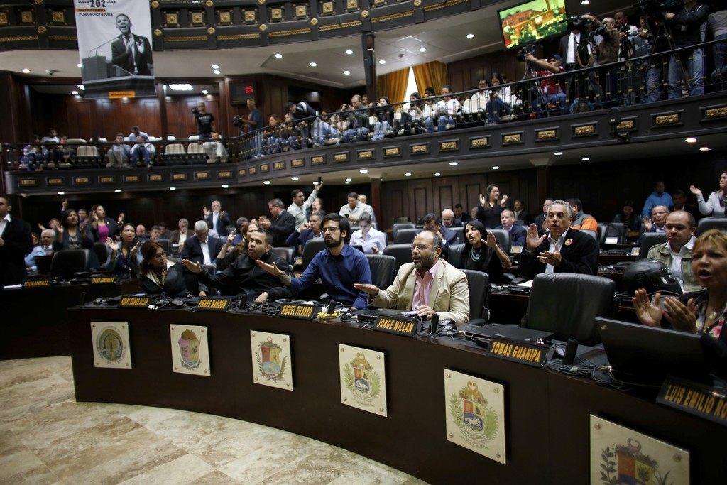 "Opposition lawmakers shout ""Fraud, fraud during a session of Venezuelan National Assembly in Caracas, Venezuela, Wednesday, Aug. 2, 2017. The CEO of t..."