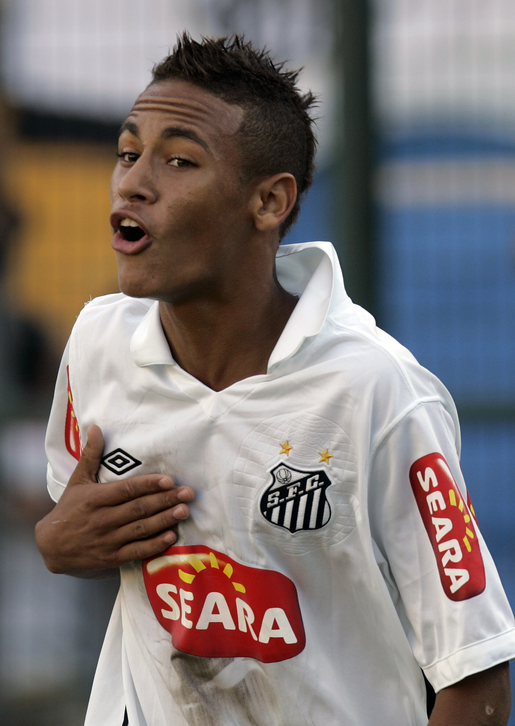 FILE - In this Sunday, May 2, 2010 file photo, Santos' Neymar celebrates after scoring during the Sao Paulo state championship soccer final match agai...