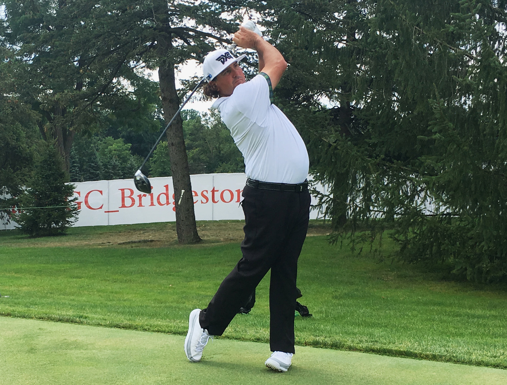 Pat Perez drives off the 13th tee during a practice round for the Bridgestone Invitational at Firestone Country Club in Akron, Ohio, Tuesday, Aug. 1, ...