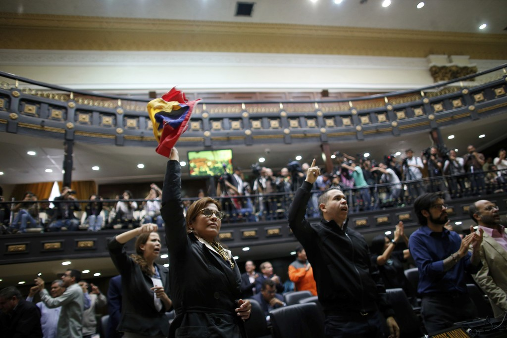 "In this Wednesday, Aug. 2, 2017 photo, anti-government lawmakers shout ""fraud"" during a session at the National Assembly in Caracas, Venezuela. The Na..."