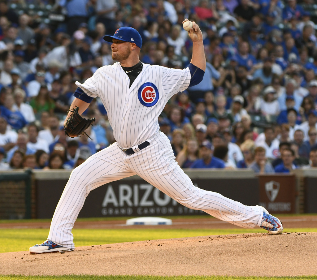 Chicago Cubs starting pitcher Jon Lester (34) delivers during the first inning of a baseball game against the Arizona Diamondbacks on Tuesday, Aug. 1,...