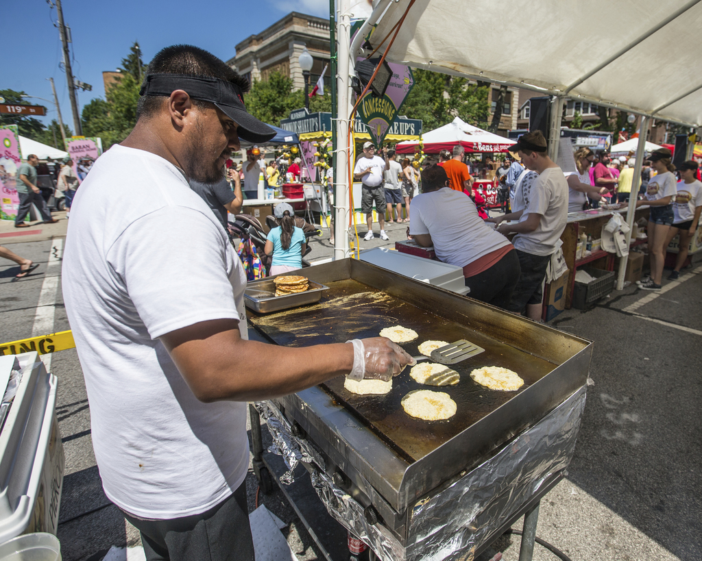 Workers at Kasia's Pierogi cook potato pancakes along with their famous Pierogi at a food festival in Whiting, Ind., July 28, 2017. The suburban Chica...