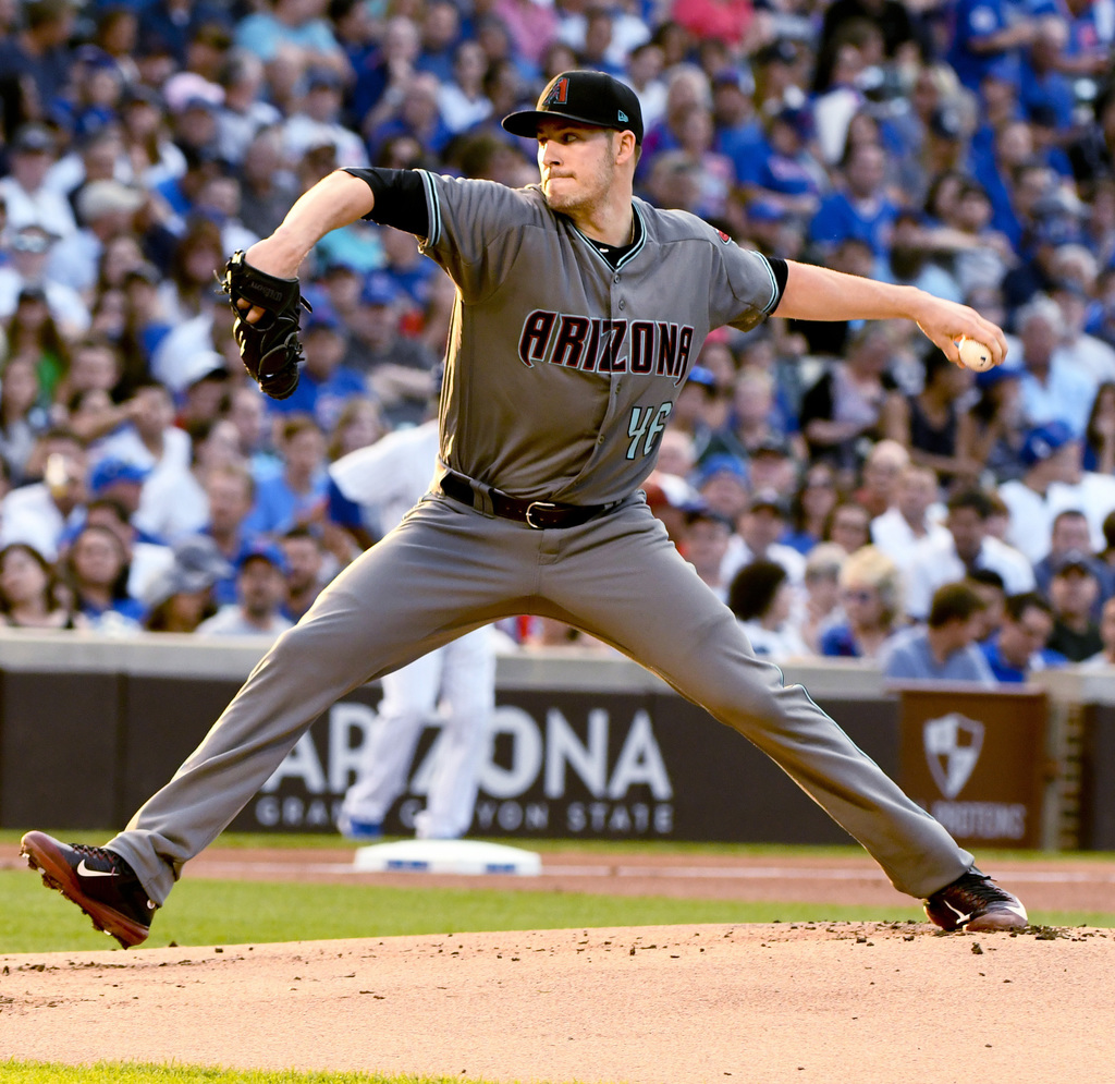 Arizona Diamondbacks starting pitcher Patrick Corbin (46) delivers during the first inning of a baseball game against the Chicago Cubs on Tuesday, Aug...
