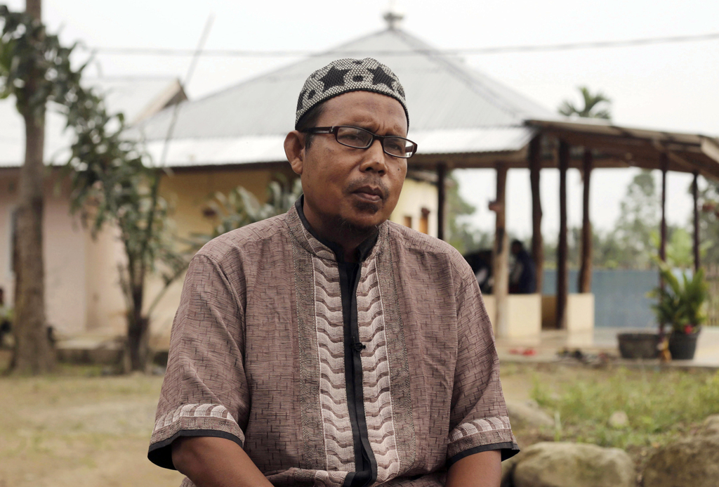 In this July 22, 2017, photo, former radical preacher Khairul Ghazali pauses during an interview with The Associated Press at Al Hidayah Islamic Board...