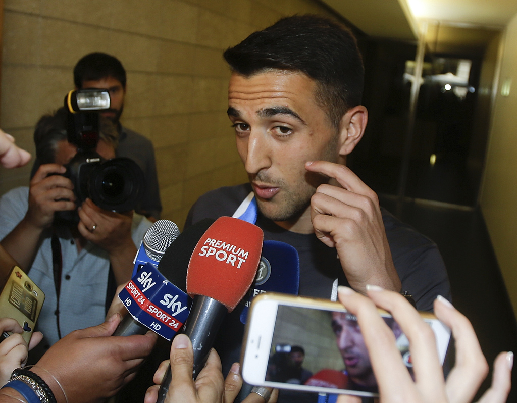 Uruguayan midfielder Matias Vecino is surrounded by reporters at the Inter Milan soccer team headquarters, in Milan, Italy, Tuesday, Aug. 1, 2017.  Ve...