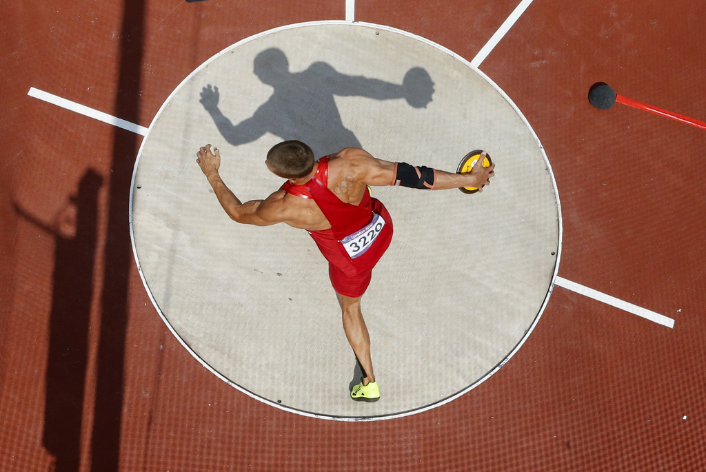 FILE - In this Aug. 9, 2012, file photo, United State's Trey Hardee competes in the men's decathlon discus throw event at the London 2012 Olympic Game...