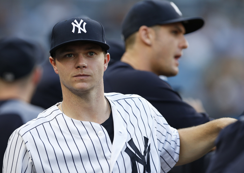 New York Yankees starting pitcher Sonny Gray, left, who arrived from the West coast Tuesday afternoon following a trade from the Oakland Athletics, lo...