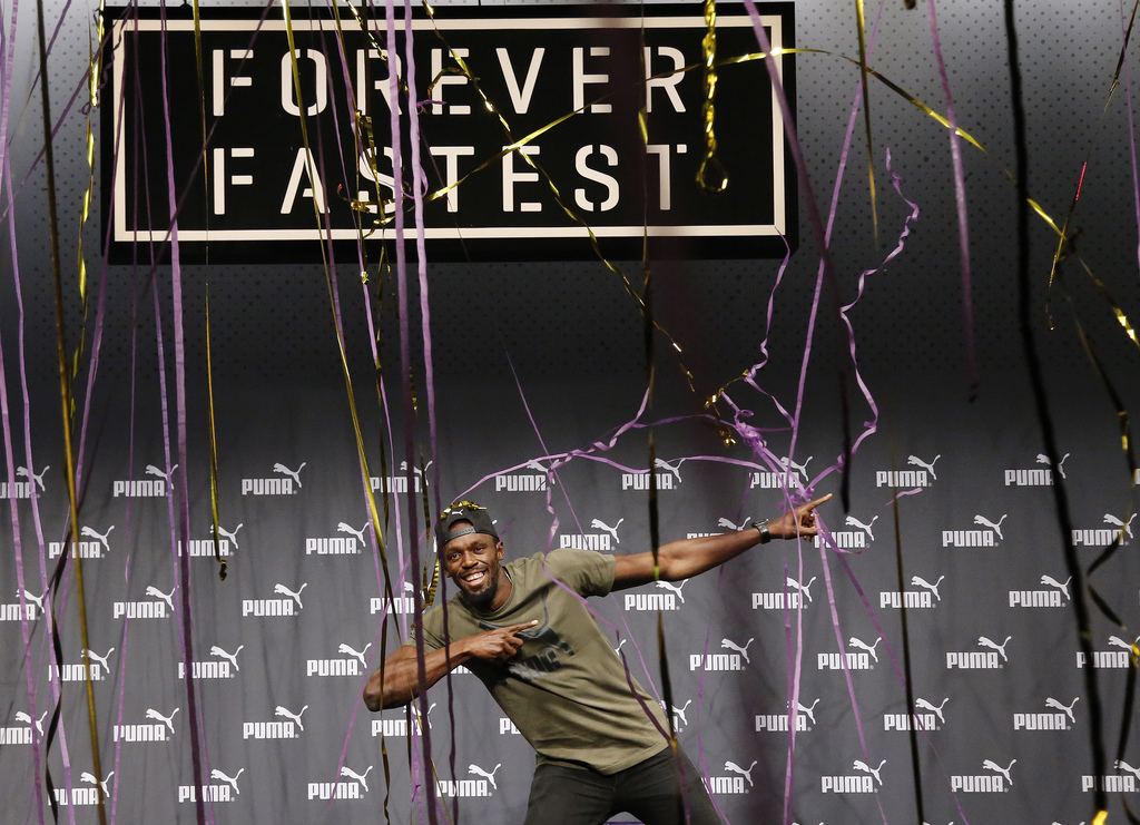 Jamaican athlete Usain Bolt celebrates after a press conference ahead of the World Athletics championships in London, Tuesday, Aug. 1, 2017. Sprint le...