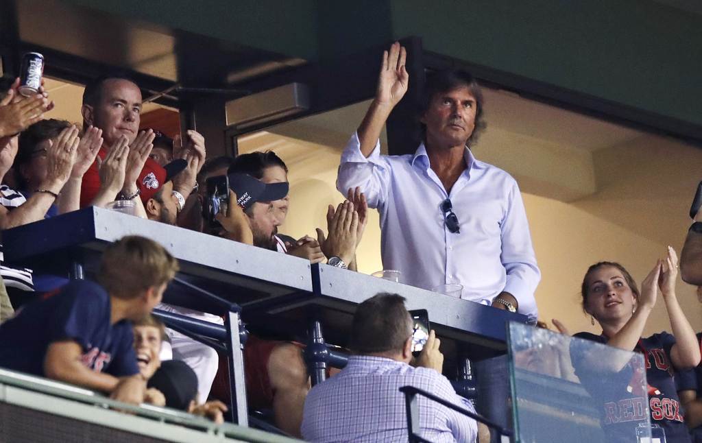 Hall of Fame pitcher Dennis Eckersley waves as fans applaud when he is honored between innings of a baseball game between the Boston Red Sox and Cleve...