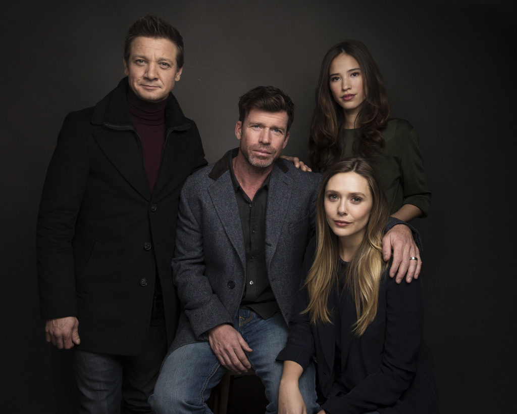 FILE - In this Jan. 21, 2017 file photo, actor Jeremy Renner, from left, Director Taylor Sheridan, actress Elizabeth Olsen and actress Kelsey Asbille ...