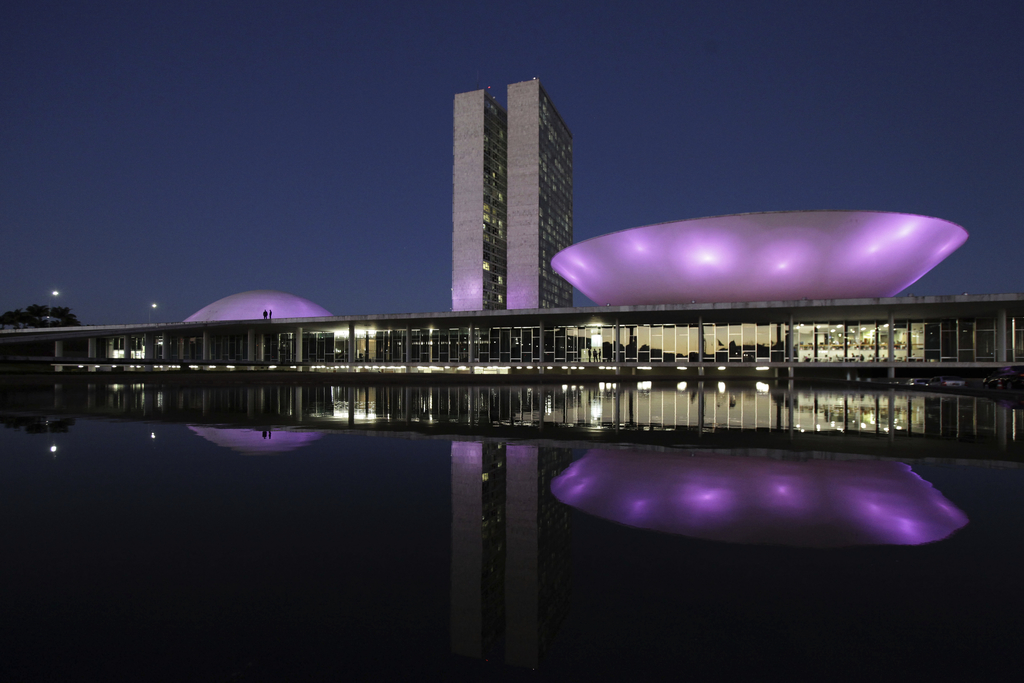 The National Congress is illuminated at night, reflected in a reflecting pool, in Brasilia, Brazil, Tuesday, Aug. 1, 2017. Brazil's President Michel T...