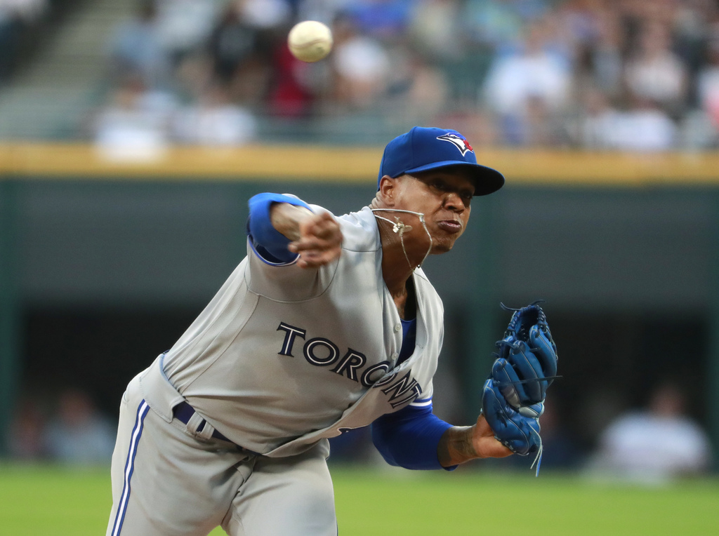 Toronto Blue Jays starting pitcher Marcus Stroman throws during the first inning of the team's baseball game against the Chicago White Sox in Chicago,...