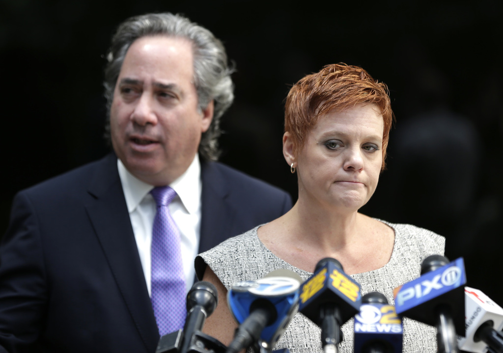 Dianne Grossman, mother of Mallory Grossman, speaks to reporters while her attorney Bruce Nagel looks on during a news conference in Roseland, N.J., T...
