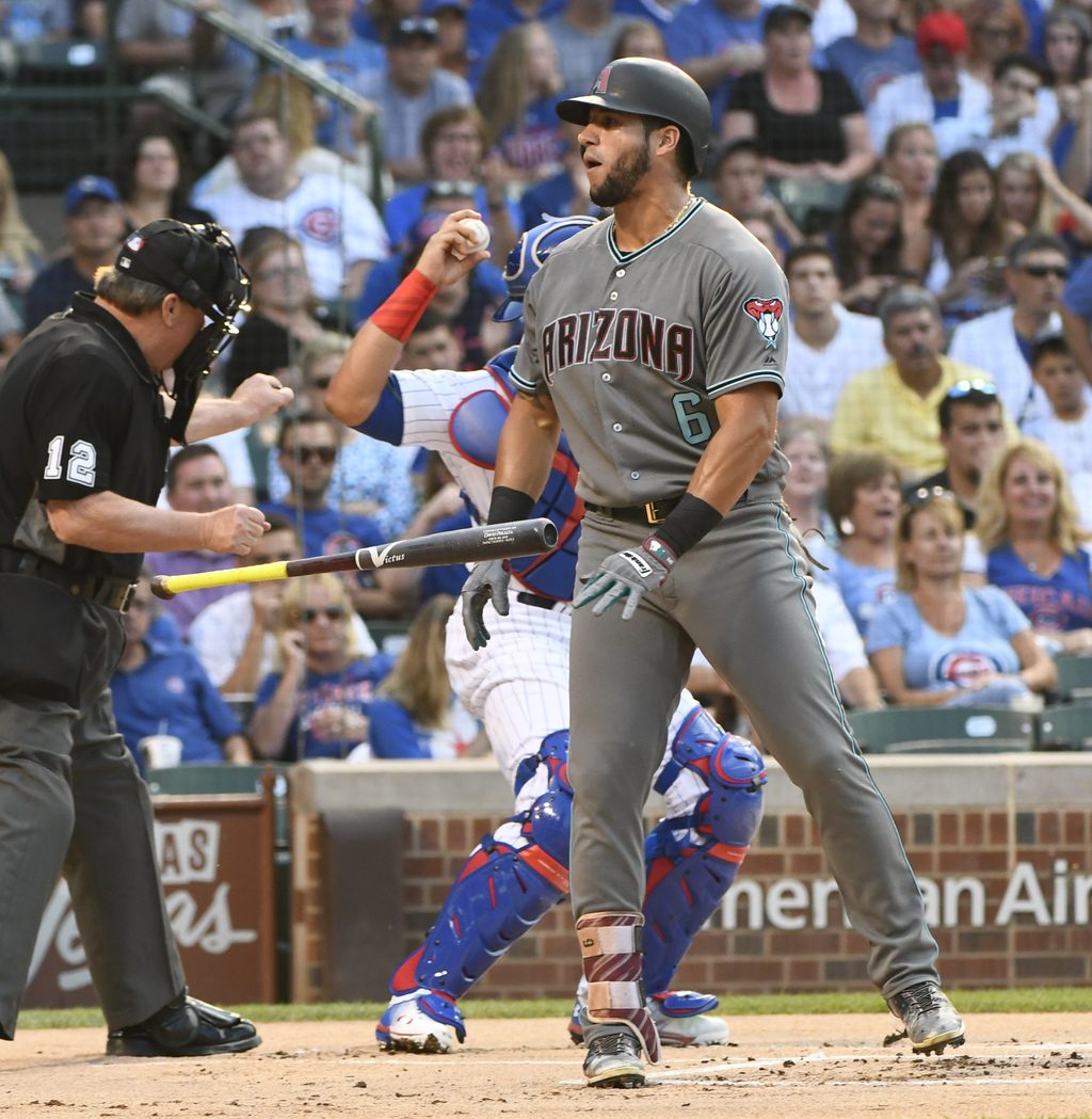 Arizona Diamondbacks David Peralta (6) flips his bat after being called out on strikes during the first inning of a baseball game against the Chicago ...