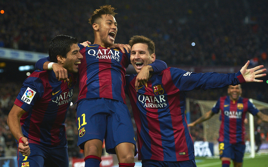 FILE - In this Sunday, Jan. 11, 2015 file photo, FC Barcelona's Lionel Messi, right, Neymar, center, and Luis Suarez, celebrate after scoring against ...