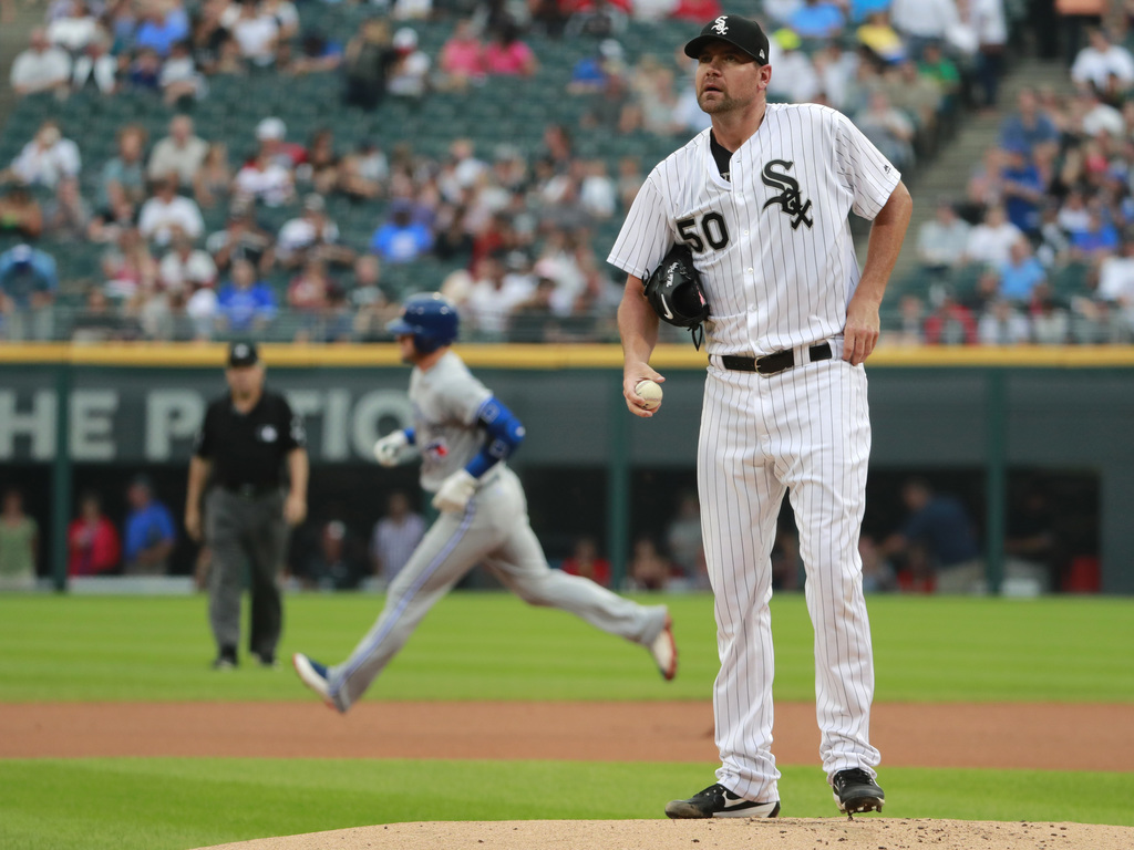 Chicago White Sox starting pitcher Mike Pelfrey (50) stands on the mound after giving up a home run to Toronto Blue Jays' Josh Donaldson, rear, during...