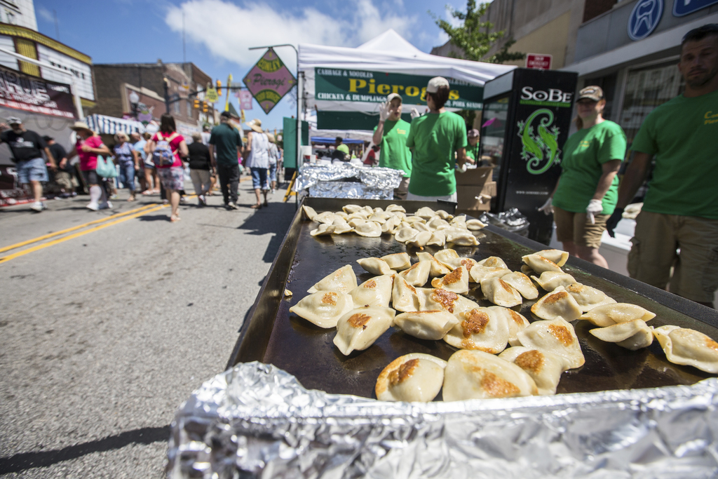 Pierogis cook on the flat top at Conley Pierogis at a food festival in Whiting, Ind., July 28, 2017. The suburban Chicago food festival says it's just...