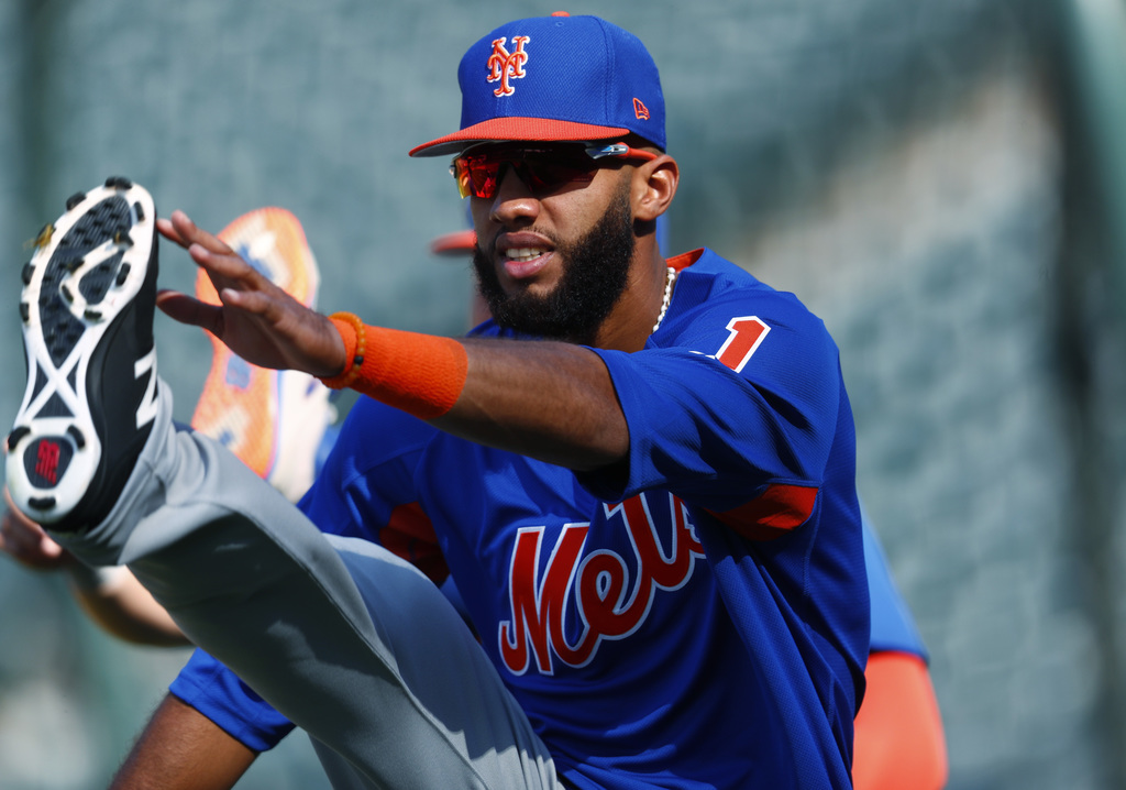 New York Mets shortstop Amed Rosario stretches during batting practice for the team's baseball game against the Colorado Rockies on Tuesday, Aug. 1, 2...