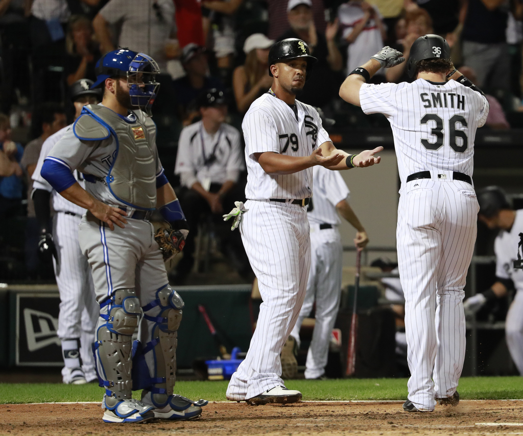 Chicago White Sox's Jose Abreu (79) greets Kevan Smith (36) after his two-run home run as Toronto Blue Jays catcher Russell Martin, left, watches duri...
