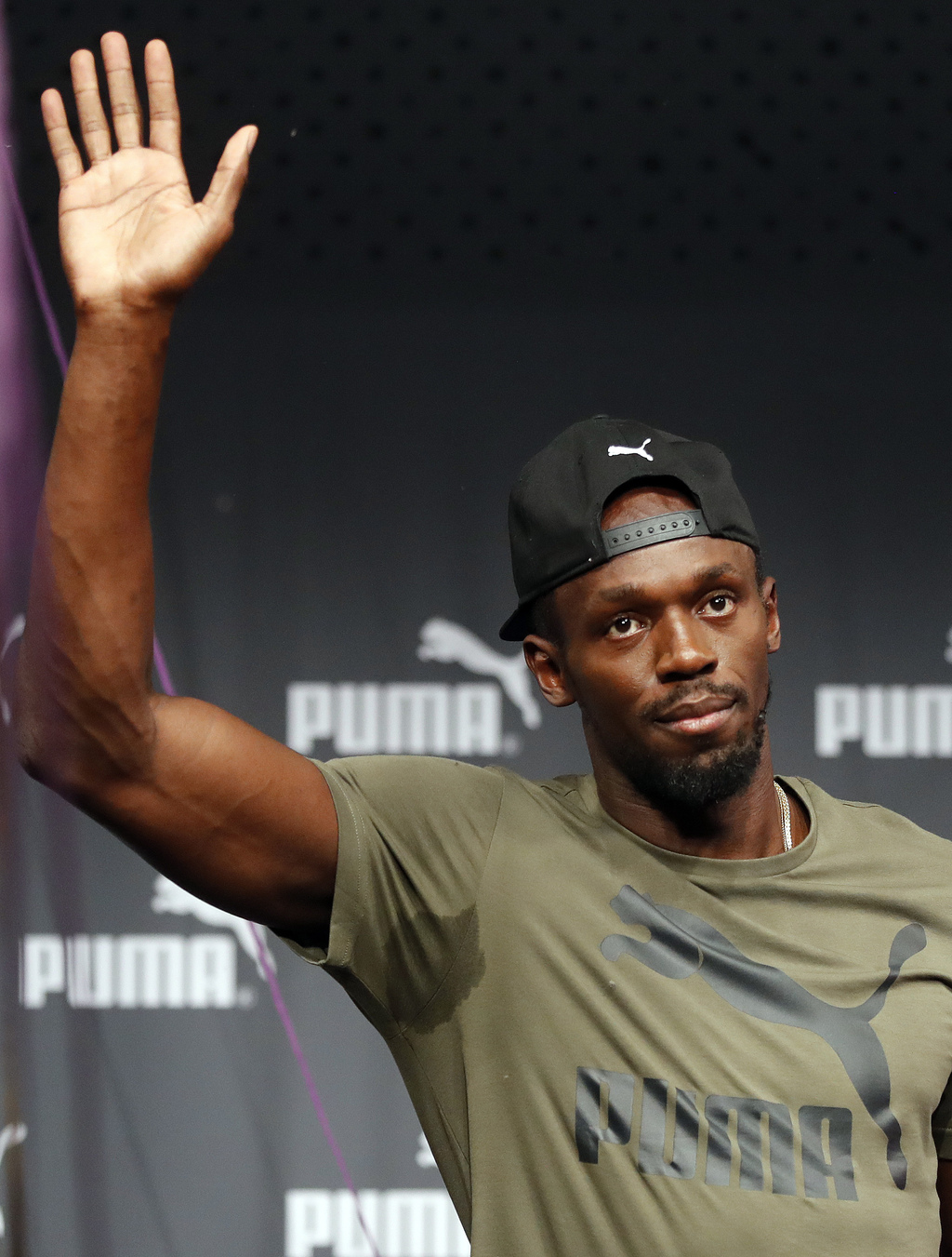 Jamaican athlete Usain Bolt waves after a press conference ahead of the World Athletics championships in London, Tuesday, Aug. 1, 2017. Sprint legend ...
