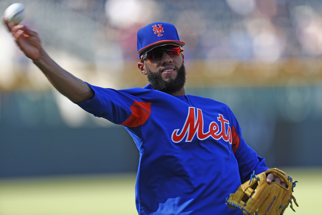 New York Mets shortstop Amed Rosario throws during batting practice for the team's baseball game against the Colorado Rockies on Tuesday, Aug. 1, 2017...
