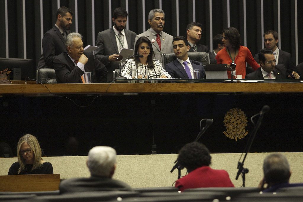 Deputy Mariana Carvalho, center, reads the report of the complaint against Brazil's President Michel Temer by the Committee on Constitution and Justic...