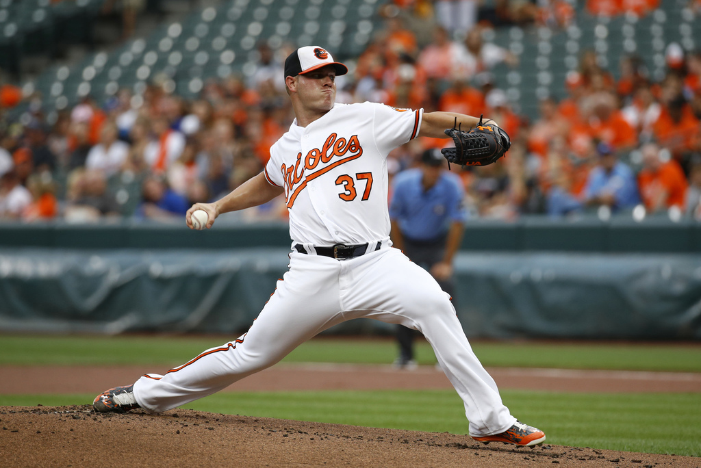 Baltimore Orioles starting pitcher Dylan Bundy throws to the Kansas City Royals in the first inning of a baseball game in Baltimore, Tuesday, Aug. 1, ...