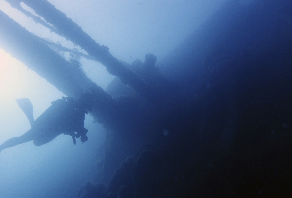 In this Tuesday, July 18, 2017 photo, a diver swims under part of the Italian World War II shipwreck MV Probitas in Saranda Bay, southern Albania. On ...