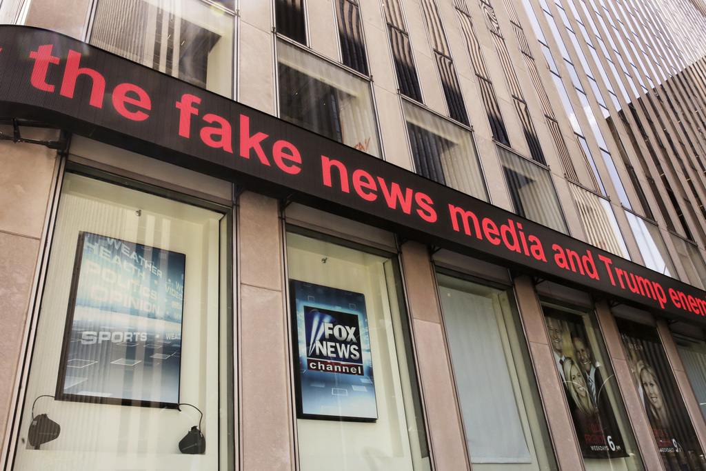 News headlines scroll above the Fox News studios in the News Corporation headquarters building in New York, Tuesday, Aug. 1, 2017.  Fox contributor Ro...