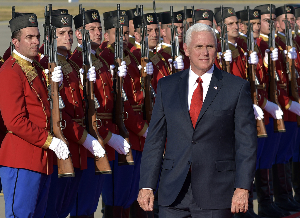U.S. Vice President Mike Pence attends a welcome ceremony at Golubovci airport, near Podgorica, Montenegro, Tuesday, Aug. 1, 2017. Pence will attend t...